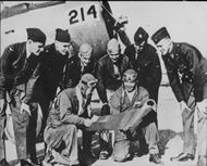 Six allied pilots from China, Cuba, England, Australia and the USA study a map at the airport in Phoenix, Arizona