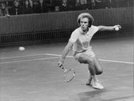 Tennis player Ray Moore in action