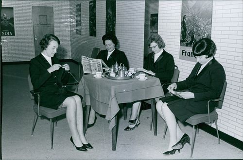 Ladies are reading newspapers. March 16, 1967