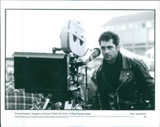 "Director Charles T. Kanganis on the set of ""Race the Sun""."