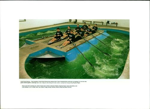 Oxford crew members are seen in training at club's indoor rowing tank