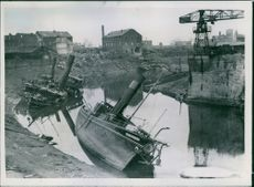 Obsolete boats sinking in river after capture in Duisburg.