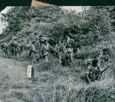 A group of soldiers hiding in the forest during Western imperialism in Asia.