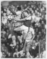 Cyrille Regis and Kevin Richardson fight for the ball