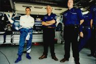 Rickard Rydell and parts of his team monitor the events on the track Brands Hatch.