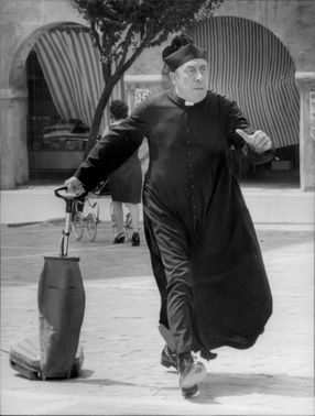 "Fernandel as Don Camillo in the movie ""Don Camillo and the teenagers""."