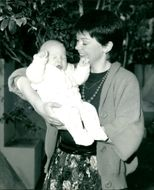 Isla St Clair with her baby