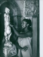 Marpessa Dawn looking at a sculpture in Cannes. 1959.