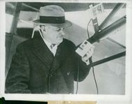 Mr Henerickson stands with his invention that warn aircraft before the thaw.