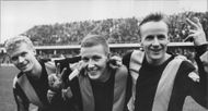 Three happy football players in Hammarby IF