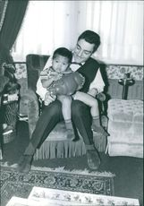 Man playing with boy.