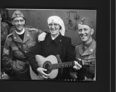 Sister Ida who has been on Java for 15 years entertained with Pastor Pallin the Red Cross troops on their way to Lübec,with Chinese songs on departure. - 19 June 1945
