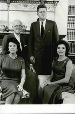 Rose and Joseph Kennedy pose with their son John F. Kennedy and his wife Jackie Bouvier Kennedy