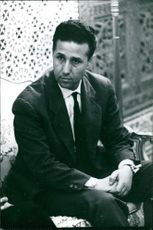 Mohammed Ben Bella in a portrait, sitting.