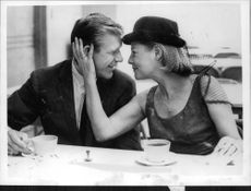 June Allyson sitting with a man.