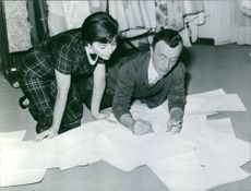 Emilio Federico Schuberth seen creating his designs while laying on the floor.