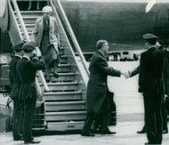 The Swedish royal couple meets by Lord and Lady Mountbatten on arrival at Central Airport in London.