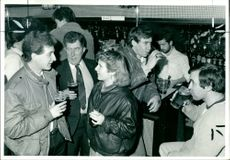 Drinkers at a London pub.