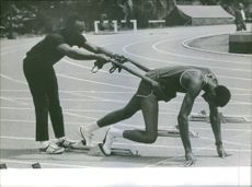 A photo of a marathon athlete is being prep in his final form before staring the run in 1968 Summer Olympics in Mexico.