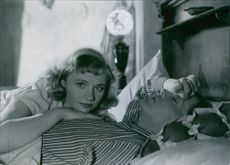 "Gunn Wållgren and Sture Lagerwall in a scene from the 1945 film, ""Resan Bort""."