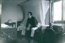 A man sitting in a room.