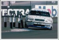 Rickard Rydell uses the curb during the race at Donnington Park.