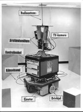 Picture of an early robot with a radio antenna, a TV camera, proximity sensor, control unit, touch probe, electric motor and drive wheels