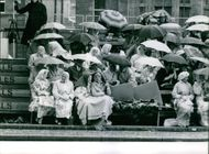 Women in the shade of their umbrellas.