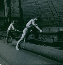 Men looking at a wreck ship in Oslofjord during the war, Norway, 1949.