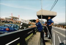 Rickard Rydell's team leaves instructions through the pit board during the BTCC competition at Brands Hatch.