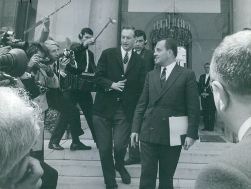 People running behind to take interview and photographs of The Theule Joel,  1968.
