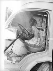 Soldier inside the car with a dead man during the Algerian War, 1961.