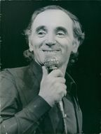 French and Armenian personality, Charles Aznavour, on the microphone. 1976.