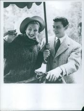 Man and woman smiling.