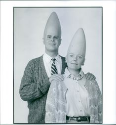 Dan Aykroyd and Jane Curtin posing and smiling during a scene of film Coneheads.