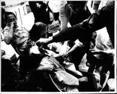 Fainted people being treated.