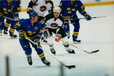 Sportsmen playing ice hockey for Olympics Games.