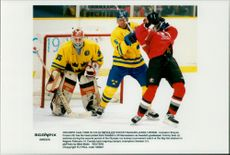 Canada's Shayne Corson came in close combat with Ulf Samuelsson outside the Swedish goalkeeper guarded by Tommy Salo.