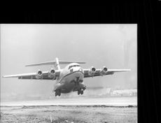 A prototype of a YC-15 transport aircraft is lifting