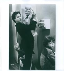 """Michael Keaton with the kids in a scene from  a 1983 American comedy film, """"Mr. Mom."""""""