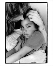 A woman embracing a child.
