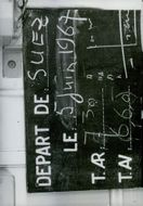 A board showing the departure going to Suez Canal 1968