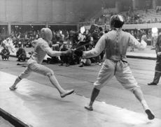 Athletes playing fencing