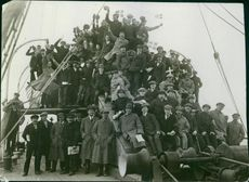 Soldiers standing together on the boat, facing camera.