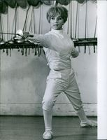 Marie France Anglade seen doing fencing exercises. 1966.