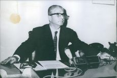 A man sitting at his desk.