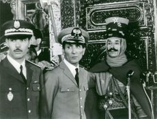 Mehdi Ben Barka standing with two officers.1966