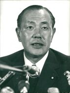 Kakuei Tanaka is speaking at a press conference