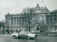 Parliament building with police car parked in front of
