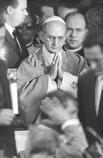 Pope Paul VI with hands joined.